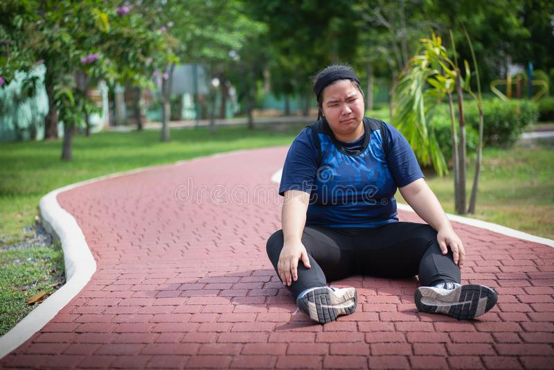 Fat women running and tired stock photos