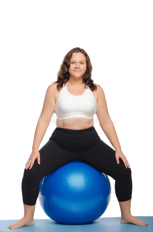 Fat woman sitting on blue ball fitness. Isolated on white royalty free stock image