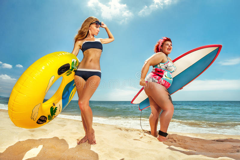 Fat woman with the surfboard royalty free stock photo