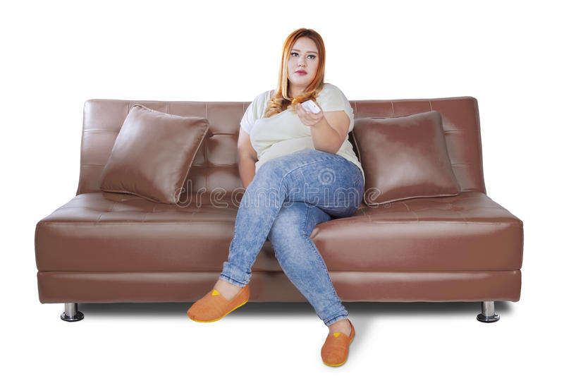 Download Fat Woman Watches Tv On Sofa Stock Photo   Image Of Remote, Pretty: