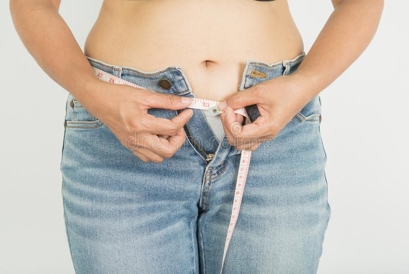 Fat and women with obesity. And Jeans royalty free stock photos