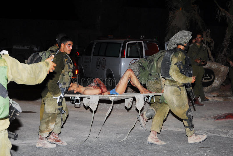 150 Fatah Men Enter Israel After fleeing Gaza Violence. NACHAL OZ, ISR - AUG 02: Injured Fatah men are fleeing into Israel with the help of Israel's Defense royalty free stock photo