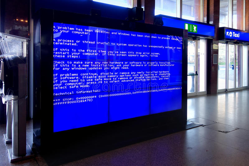 Fatal system computer error Videowall. Rome, Italy - Jan 2015: The Blue Screen of Death in the video wall at termini railway station in Rome that is an error stock image