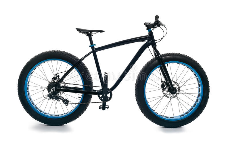 Fatbike fat bike or fat-tire bike. Fatbike also called fat bike or fat-tire bike - Cycling on large wheels. Isolate. Side view the full size royalty free stock photo