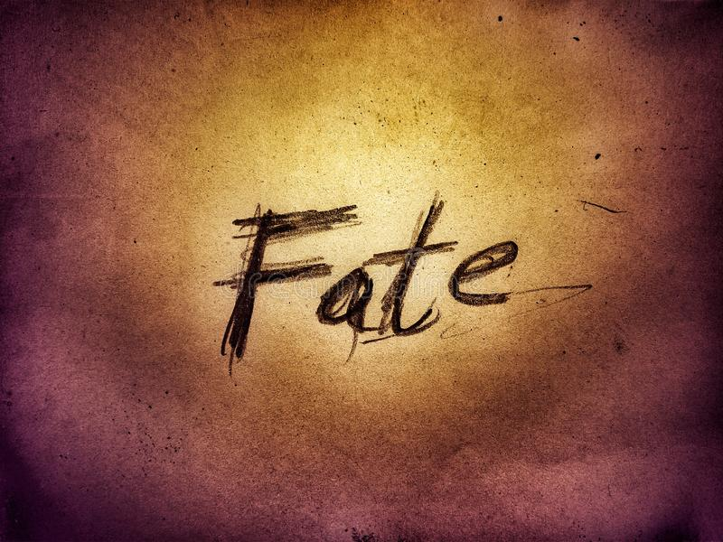 Fate rough style written word on the bright golden color paper page wall stock images