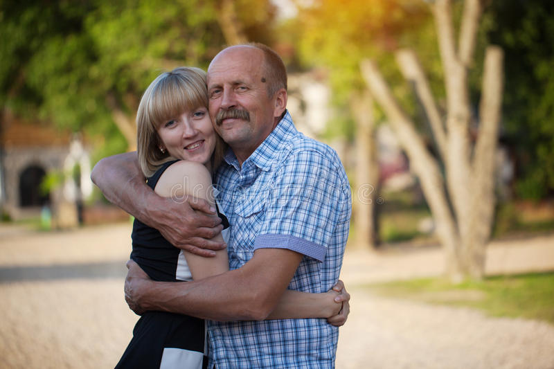 The father and the adult daughter embrace, a happy family, outdo royalty free stock images