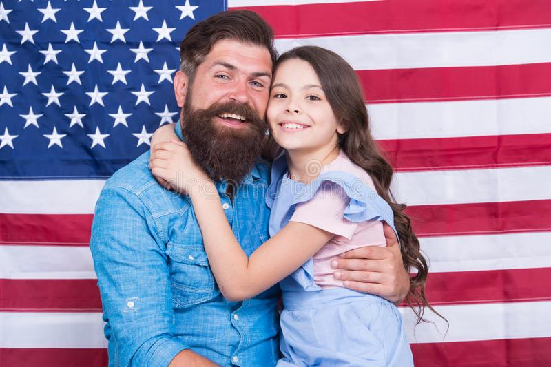 Father american bearded hipster and cute little daughter with USA flag. Freedom fundamental right. How do americans. Celebrate independence day. Independence is royalty free stock images