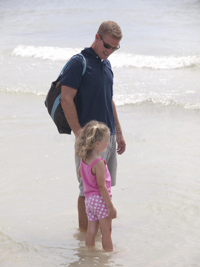 Free Father And Daughter Walking On The Beach Royalty Free Stock Image - 15384356