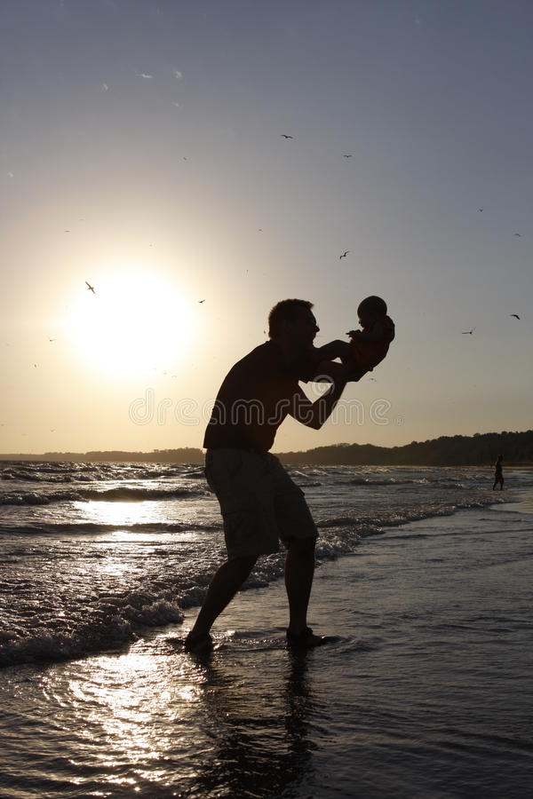 Download Father And Baby On Beach At Sunrise Stock Image - Image of lake, bonding: 16884861