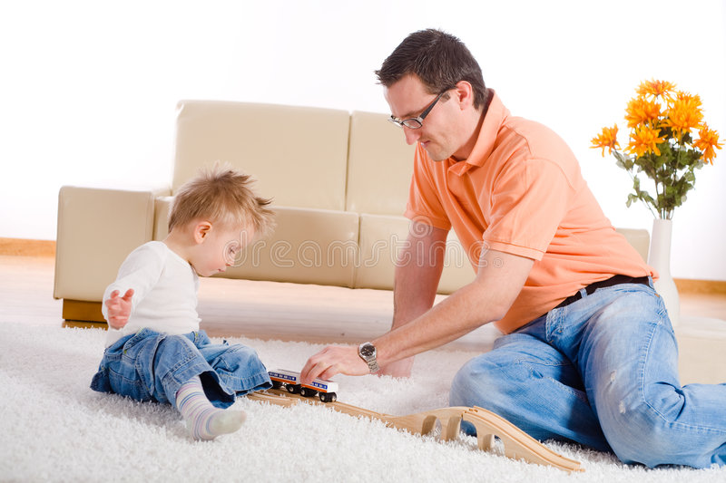 Father and baby boy playing stock image