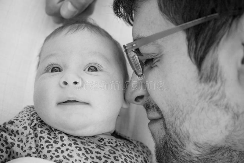 Father with baby girl close-up in black and white - Monochrome family togetherness concept - Father and daughter love monochrome - royalty free stock images