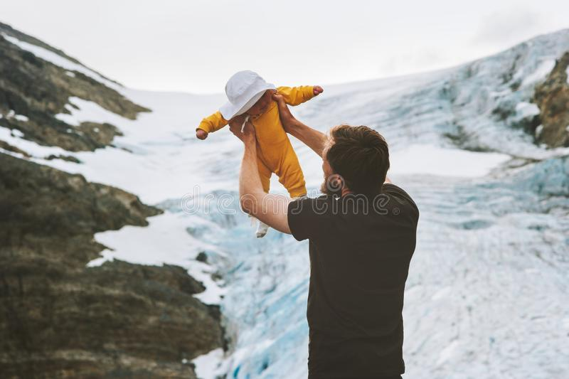 Father with baby hiking together in mountains travel with kids royalty free stock photo