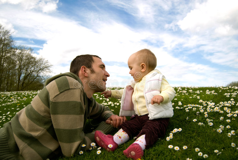 Father with the baby outside stock photography