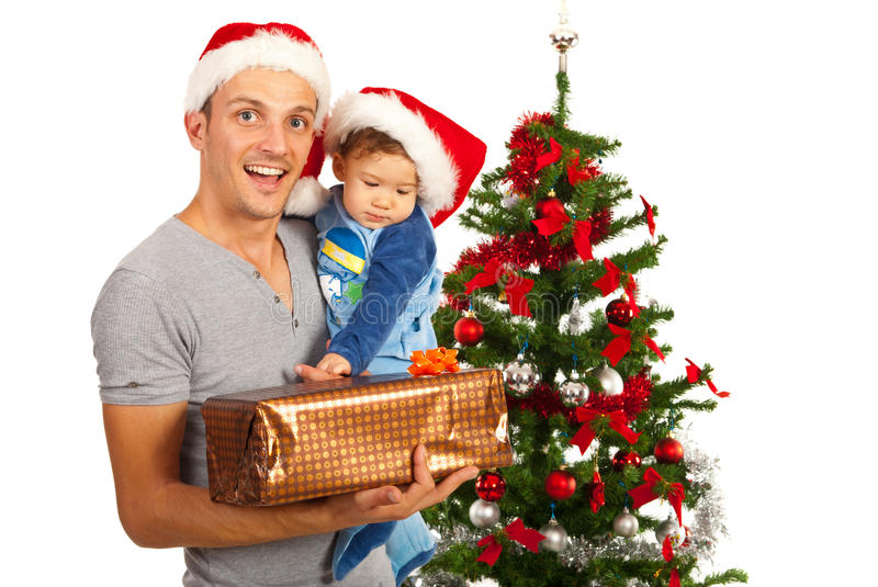 Father with baby and Xmas gift. Amazed father holding baby and Christmas present royalty free stock photography