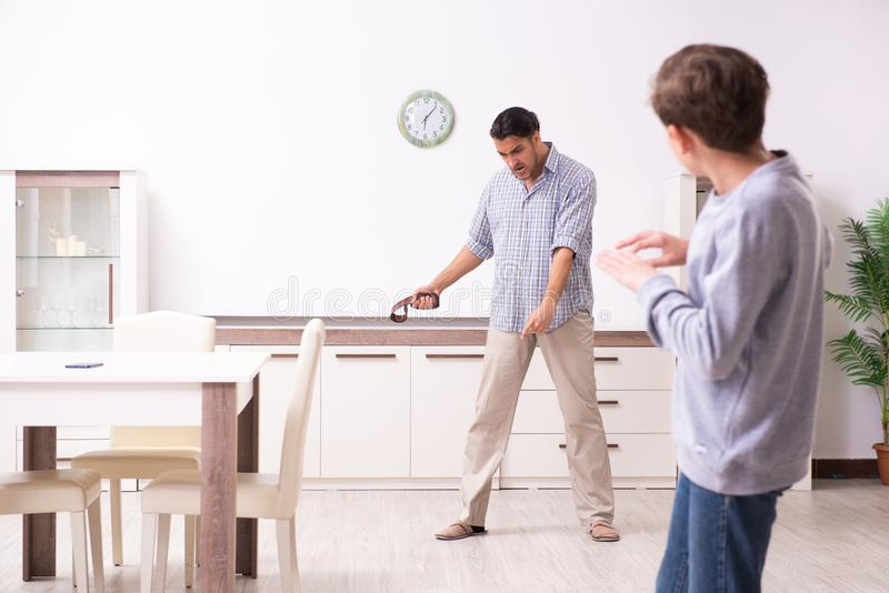 Father beating and punishing his sone. The father beating and punishing his sone royalty free stock photos