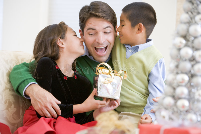 Father Being Given A Christmas Present royalty free stock images