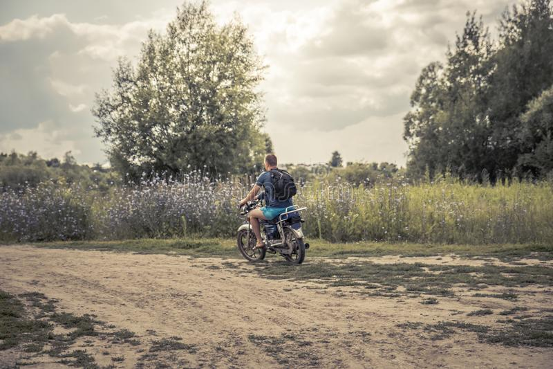 Father biker son riding motorcycle countryside road concept road trip royalty free stock photos