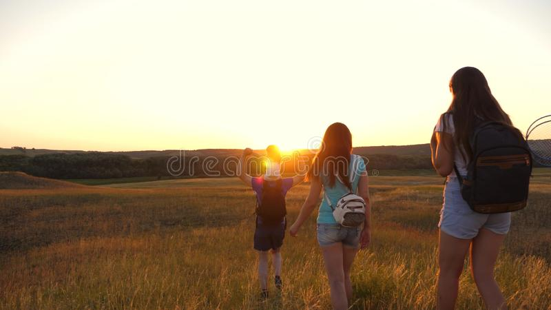 Father carries a little daughter on his shoulders, a happy family travels in the park. Family with children travels on royalty free stock photo