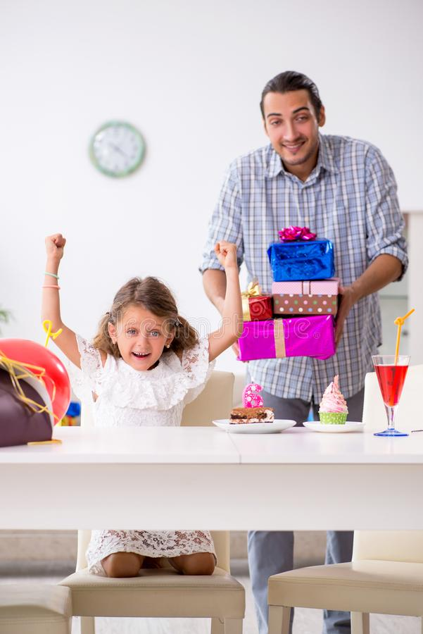 Father celebrating birthday with his daughter. The father celebrating birthday with his daughter royalty free stock photography
