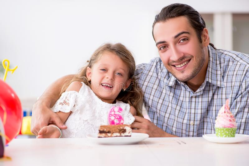 Father celebrating birthday with his daughter. The father celebrating birthday with his daughter stock images