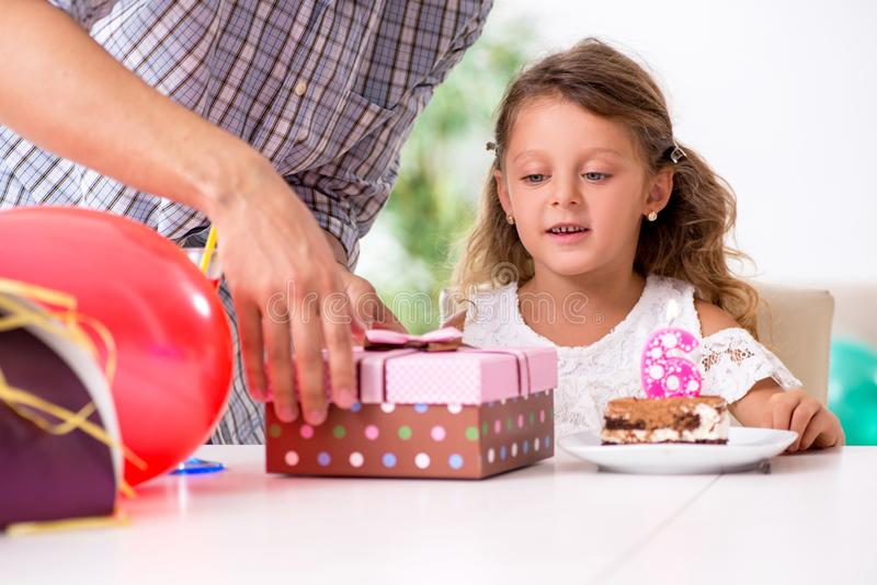 Father celebrating birthday with his daughter. The father celebrating birthday with his daughter royalty free stock images