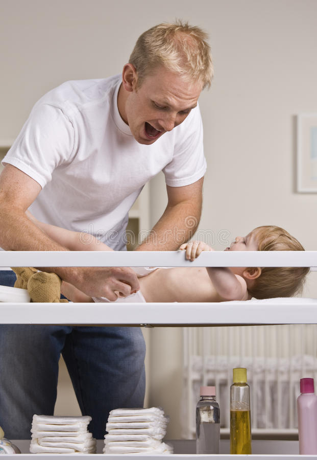 Free Father Changing Diapers Stock Photos - 10196443