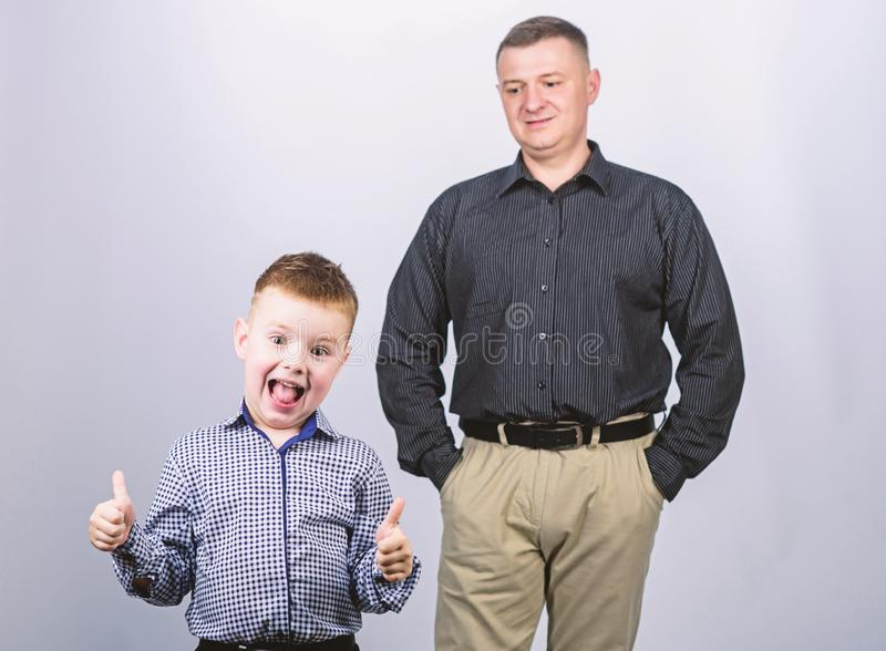 Father and cheerful little son. Best friends. Dad and adorable child. Father example of noble human. Family support. Family bonds. Trustful relations father stock image