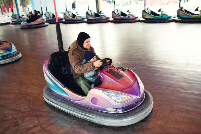 Download Father And Child Bumper Car Stock Photo - Image of sport, park: 23331270