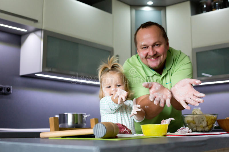 Father and child cooking. stock photo