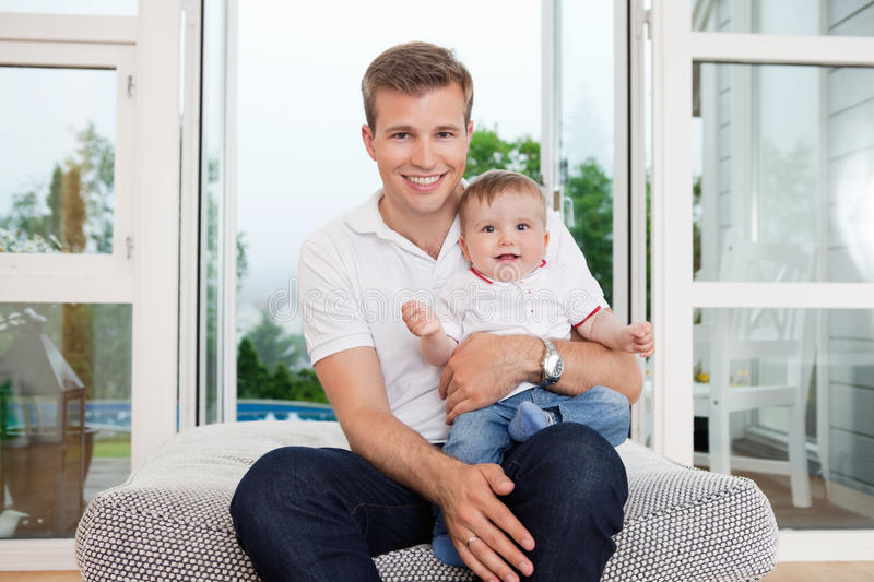 Father and child on couch royalty free stock photo