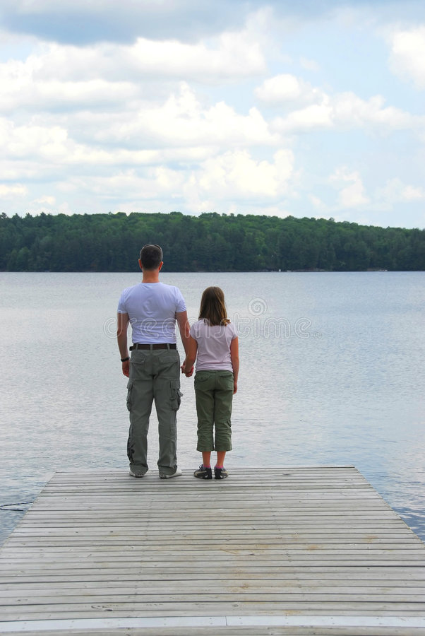 Father child lake royalty free stock photography