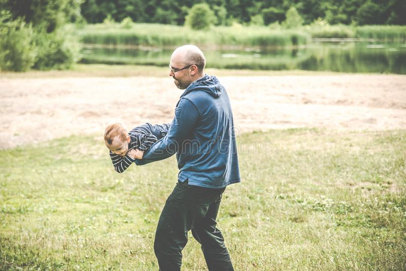 father and child outdoors stock photography