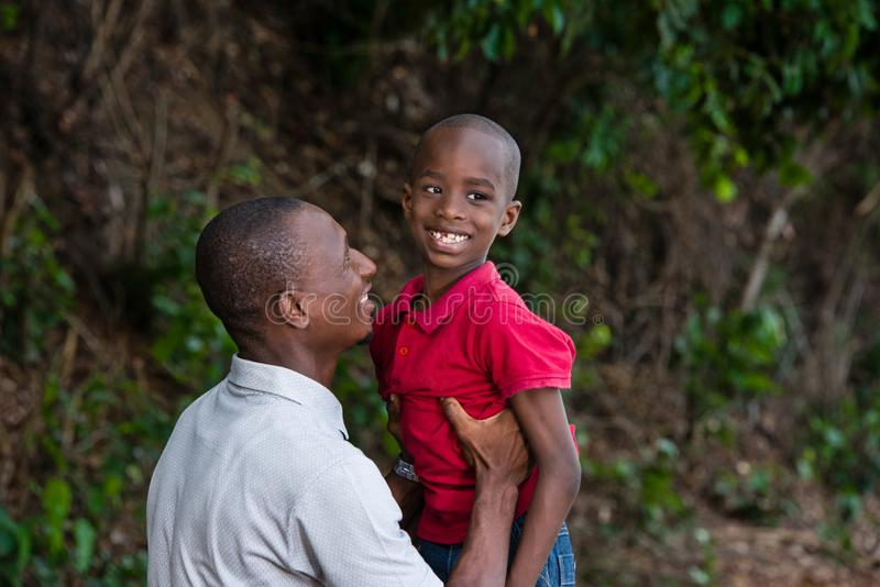 Father and child playing together outdoors. Happy family in nature, father and son spending a pleasant time together in nature.Father holding his son in the air royalty free stock photos