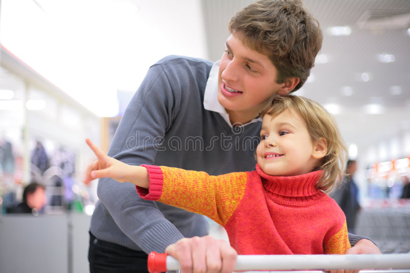 Father with child in shop. Father with little child in shop royalty free stock photo