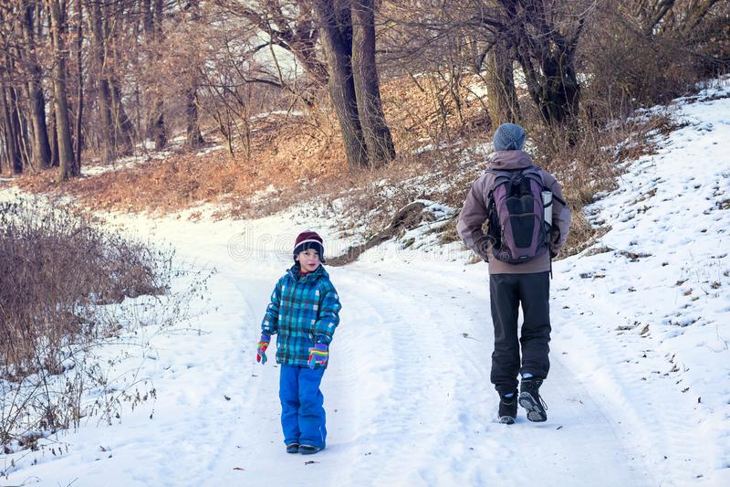 Father and child walking winter nature path royalty free stock photo