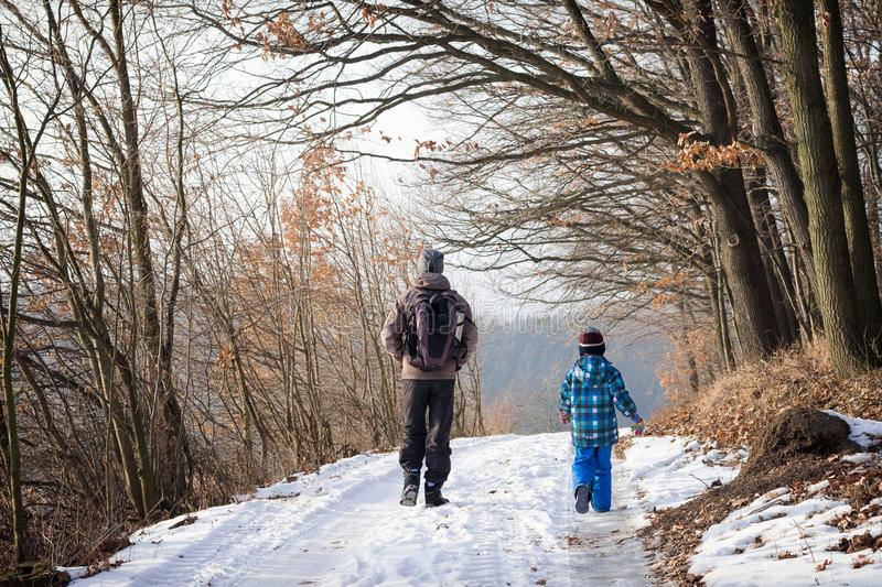 Father and child walking winter nature path stock images