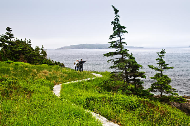 Father and children at Atlantic coast in Newfoundl stock photo