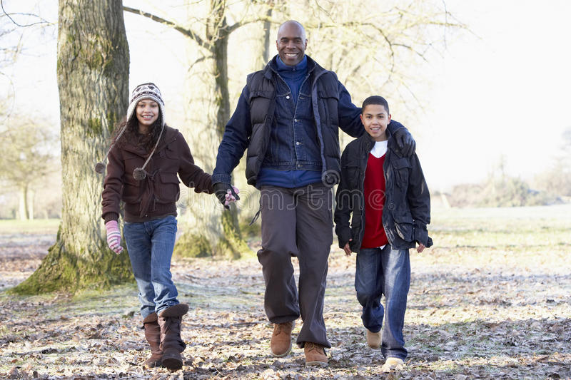 Download Father And Children On Autumn Walk Stock Photo - Image of family, happy: 9388594