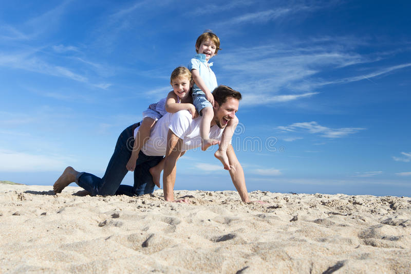 Father and children on the Beach royalty free stock photography