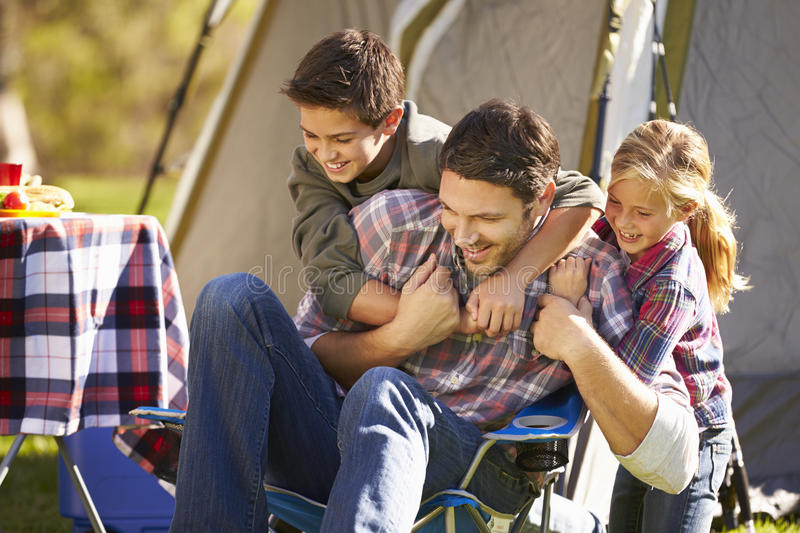 Father And Children Enjoying Camping Holiday Stock Images