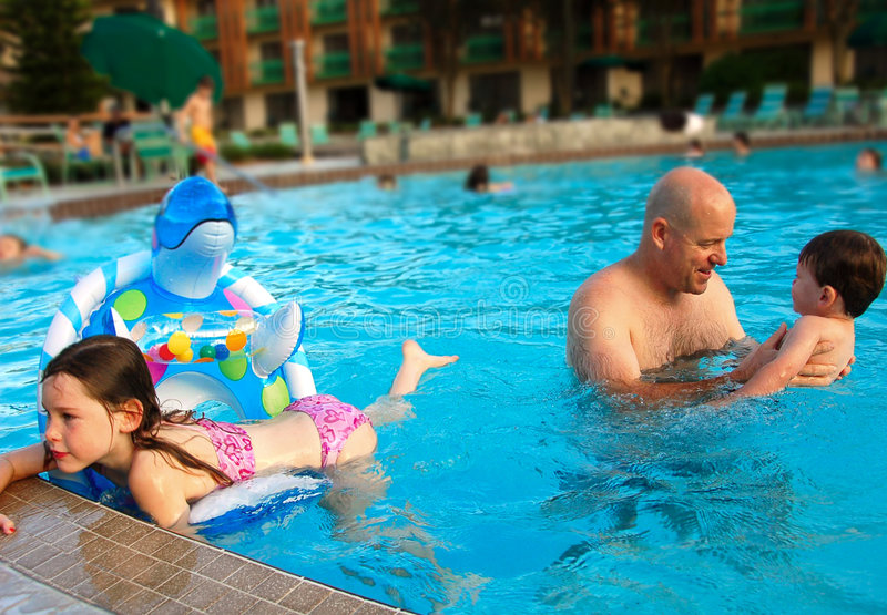 Father and Children in Pool royalty free stock photos
