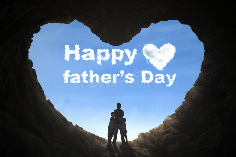 Father and children standing in cave royalty free stock photography