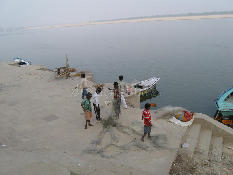 Download Father And Children Untangle Fishing Net Near Assi Ghat Varanasi India Editorial Stock Photo - Image of river, work: 78790248