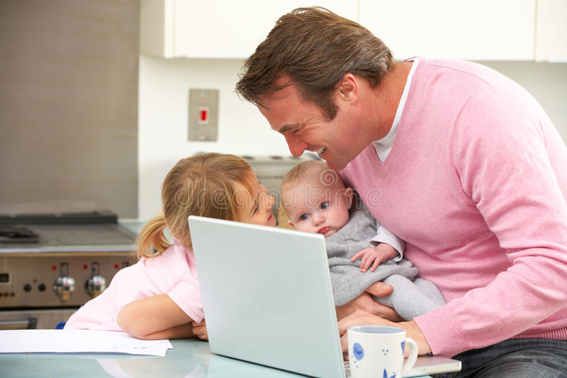 Download Father With Children Using Laptop In Kitchen Stock Photo - Image: 24161750