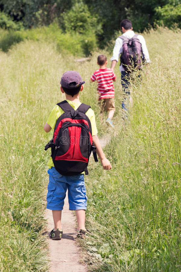 Father with children walking in nature royalty free stock photography