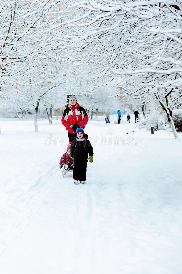 Father with children walking in winter royalty free stock photos