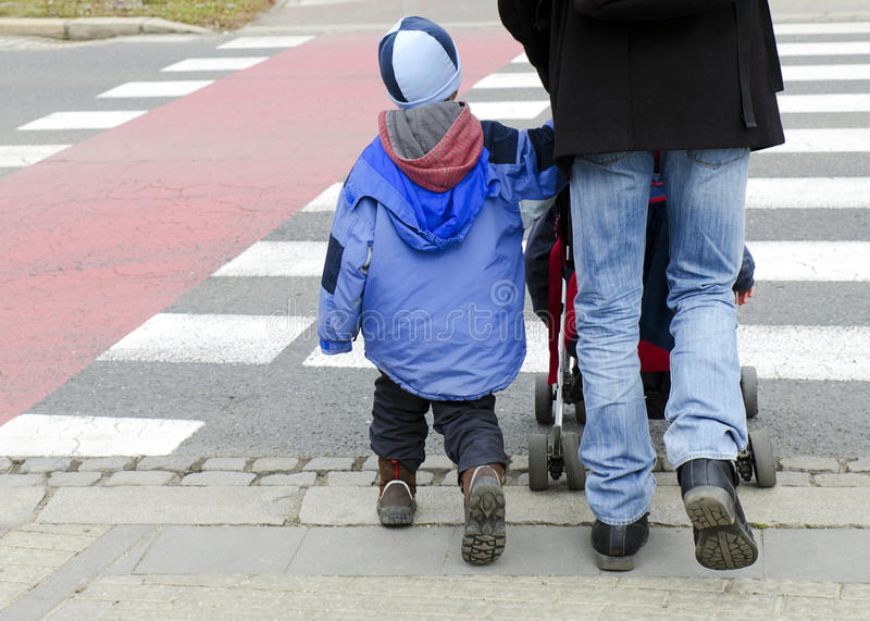 Father with children on zebra crossing royalty free stock images