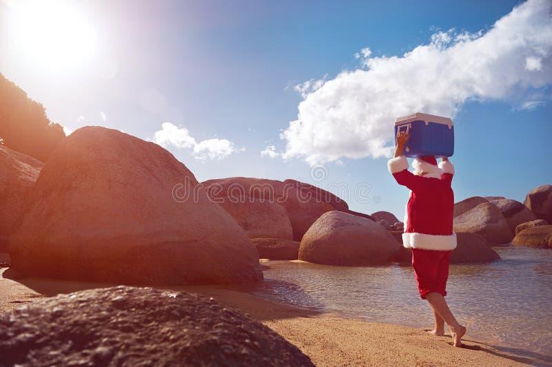 Father Christmas enjoying the sunshine stock images