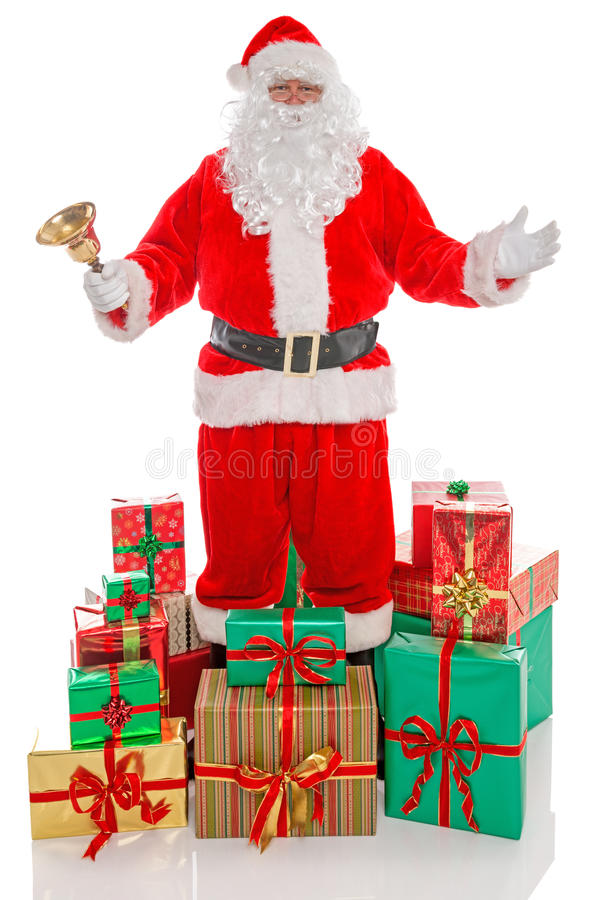 Father Christmas surrounded by presents, on white. stock image