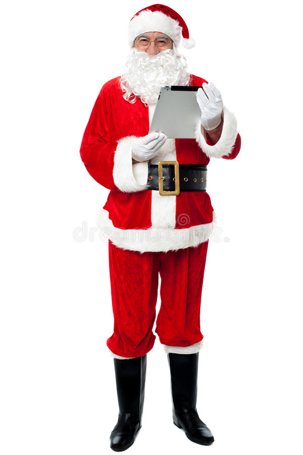 Father Christmas using new tablet device
